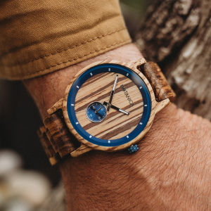 A wooden watch worn on a man's wrist