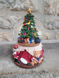 snowglobe with christmas tree inside it