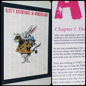A print of Alice's Adventures in Wonderland text from the book with the white rabbit depicted in the centre