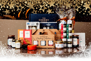 An array of The Cherry Tree's products including chutney gift sets and crackers