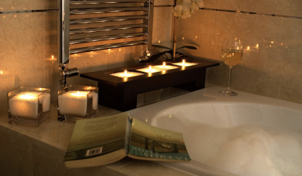 Candles shown next to a bath