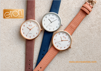 Eton watches logo, along with three wrist watches