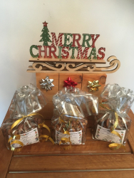Almonds, cashews and pecan in festive packaging