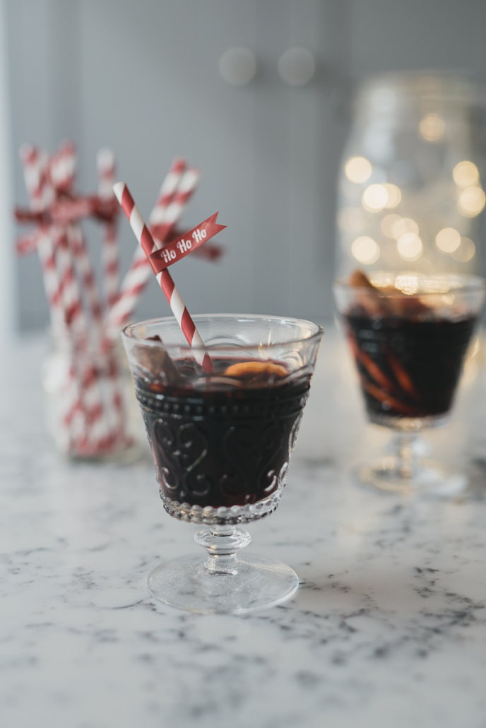 Mulled Wine in a glass with a festive paper straw